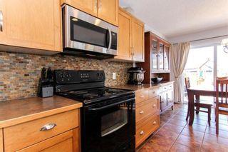 Photo 6: 944 CRANSTON Drive SE in Calgary: Cranston House for sale : MLS®# C4145156