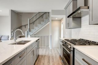 Photo 11: 1702 19 Avenue SW in Calgary: Bankview Row/Townhouse for sale : MLS®# A1078648