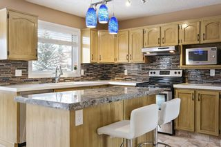 Photo 14: 312 Hawkstone Close NW in Calgary: Hawkwood Detached for sale : MLS®# A1084235