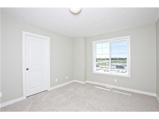 Photo 3: 111 300 MARINA Drive W in : Chestermere Townhouse for sale : MLS®# C3589237