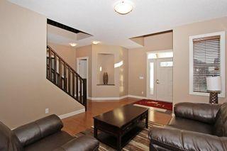 Photo 7: 241 ASPEN STONE PL SW in Calgary: Aspen Woods House for sale : MLS®# C4163587