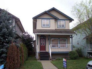 "Photo 1: 34628 7TH Avenue in Abbotsford: Poplar House for sale in ""Huntingdon Village"" : MLS®# R2048868"