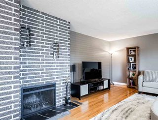 Photo 2: 1654 OUGHTON Drive in Port Coquitlam: Mary Hill House for sale : MLS®# R2571454