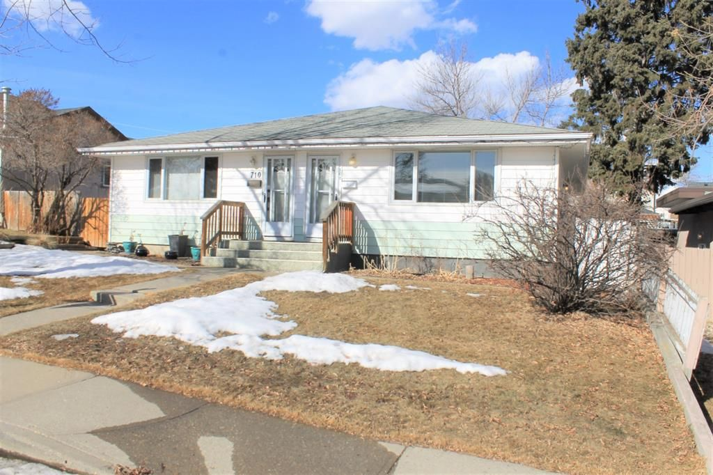 Main Photo: 708 53 Avenue SW in Calgary: Windsor Park Semi Detached for sale : MLS®# A1078390