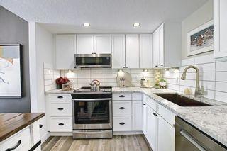Photo 9: 21 2225 Oakmoor Drive SW in Calgary: Palliser Row/Townhouse for sale : MLS®# A1129000
