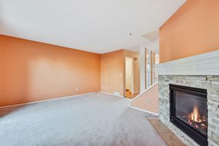 Photo 9: 105 7172 Coach Hill Road SW in Calgary: Coach Hill Row/Townhouse for sale : MLS®# A1053113