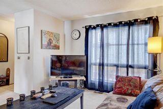 Photo 11: 203 DEERPOINT Lane SE in Calgary: Deer Ridge Row/Townhouse for sale : MLS®# C4288291
