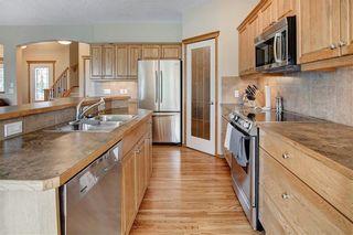 Photo 10: 244 SUNSET Close: Cochrane Detached for sale : MLS®# C4305760