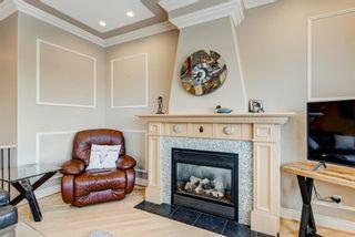 Photo 9: 227 Sunterra Ridge Place: Cochrane Detached for sale : MLS®# A1058667