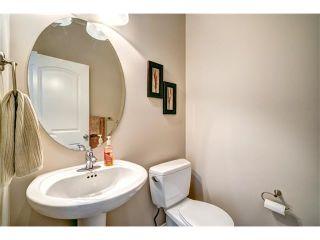 Photo 9: 109 HEARTLAND Way: Cochrane House for sale : MLS®# C4044449