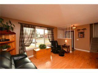 Photo 3: 34 GLENPATRICK Place: Cochrane House for sale : MLS®# C4055156