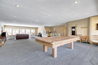 Photo 32: 324 Prominence Heights SW in Calgary: Patterson Row/Townhouse for sale : MLS®# A1071235
