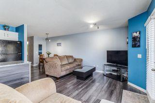 Photo 8: 139 Mt Douglas Manor SE in Calgary: McKenzie Lake Row/Townhouse for sale : MLS®# A1149851