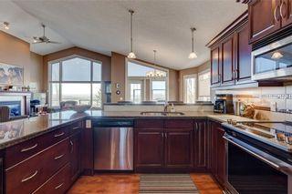 Photo 9: 206 GLENEAGLES View: Cochrane House for sale : MLS®# C4181281