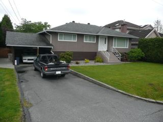 Photo 1: 8840 117A Street in N. Delta: House for sale : MLS®# F2817539