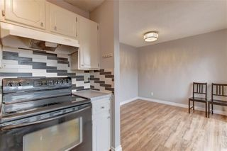 Photo 5: 104 2720 RUNDLESON Road NE in Calgary: Rundle Row/Townhouse for sale : MLS®# C4221687