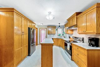 Photo 12: 56 Luxstone Crescent SW: Airdrie Detached for sale : MLS®# A1131266