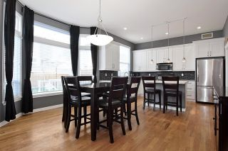 """Photo 8: 7094 200A Street in Langley: Willoughby Heights House for sale in """"WILLOUGHBY HEIGHTS"""" : MLS®# R2009244"""