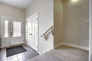 Photo 3: 309 26 Avenue NE in Calgary: Tuxedo Park Semi Detached for sale : MLS®# A1070057