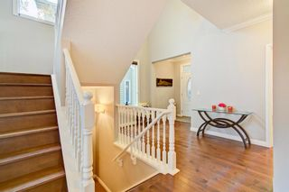 Photo 5: 28 Cougar Ridge Place SW in Calgary: Cougar Ridge Detached for sale : MLS®# A1154068