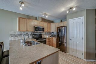 Photo 2: 702 800 Yankee Valley Boulevard SE: Airdrie Row/Townhouse for sale : MLS®# A1146510