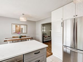 Photo 10: 63 Amiens Crescent in Calgary: Garrison Woods Semi Detached for sale : MLS®# A1098899