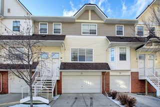 Photo 1: 25 Tuscany Springs Gardens NW in Calgary: Tuscany Row/Townhouse for sale : MLS®# A1053153