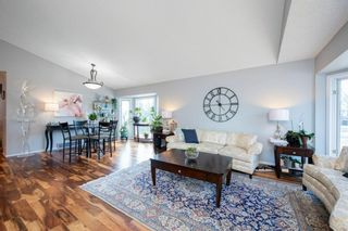 Photo 3: 88 Strathlorne Crescent SW in Calgary: Strathcona Park Detached for sale : MLS®# A1097538