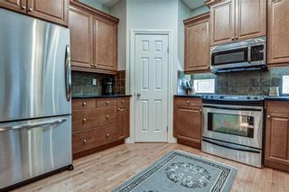 Photo 8: 7 ELYSIAN Crescent SW in Calgary: Springbank Hill Semi Detached for sale : MLS®# A1104538