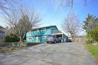 Photo 1: 13321 STAMFORD Place in Surrey: Queen Mary Park Surrey House for sale : MLS®# R2603821