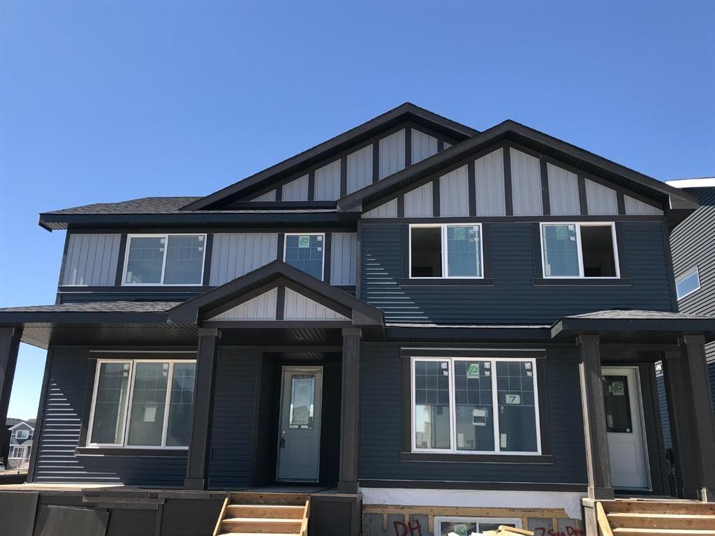 Main Photo: 3 Sundown Manor: Cochrane Semi Detached for sale : MLS®# A1089709