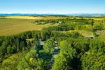 Main Photo: 261223 RANGE ROAD 35 in Rural Rocky View County: Rural Rocky View MD Detached for sale : MLS®# A1032100