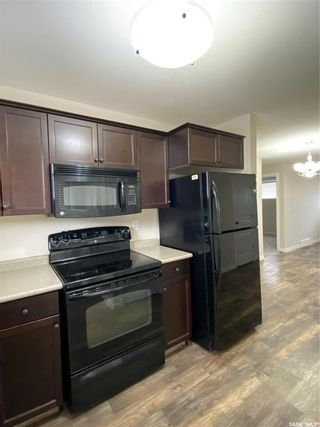 Photo 2: 15 5004 James Hill Road in Regina: Harbour Landing Residential for sale : MLS®# SK846878
