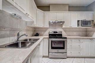 Photo 8: 2201 LAKE FRASER Court SE in Calgary: Lake Bonavista Apartment for sale : MLS®# C4223049