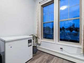 Photo 18: 213 207 SUNSET Drive: Cochrane Apartment for sale : MLS®# A1026900
