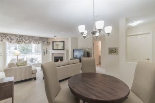 """Photo 1: 204 15290 18 Avenue in Surrey: King George Corridor Condo for sale in """"STRATFORD BY THE PARK"""" (South Surrey White Rock)  : MLS®# R2556862"""