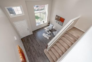 Photo 12: 122 Luxstone Road SW: Airdrie Detached for sale : MLS®# A1129612