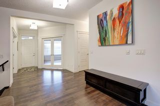Photo 11: 127 Springbluff Boulevard SW in Calgary: Springbank Hill Detached for sale : MLS®# A1140601