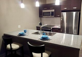 Photo 2: 403 2957 GLEN Drive in Coquitlam: North Coquitlam Condo for sale : MLS®# R2573034