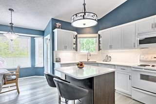 Photo 10: 64 Arbour Glen Close NW in Calgary: Arbour Lake Detached for sale : MLS®# A1117884