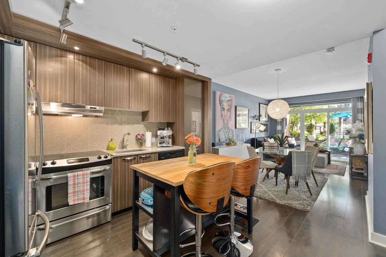 """Main Photo: 214 733 W 14TH Street in North Vancouver: Mosquito Creek Condo for sale in """"Remix"""" : MLS®# R2585098"""