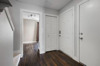 Photo 5: 311 Bridlewood Lane SW in Calgary: Bridlewood Row/Townhouse for sale : MLS®# A1136757
