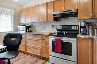 Photo 13: 9 209 Woodside Drive NW: Airdrie Row/Townhouse for sale : MLS®# A1106709