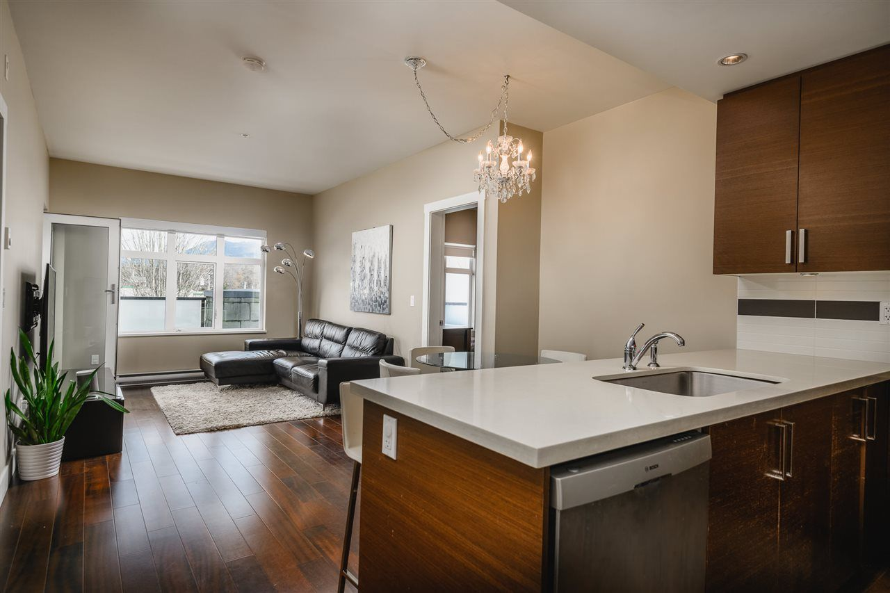Main Photo: 201 4710 HASTINGS STREET in Burnaby: Capitol Hill BN Condo for sale (Burnaby North)  : MLS®# R2555974