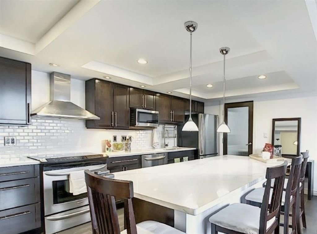 Main Photo: 504 1215 Cameron Avenue SW in Calgary: Lower Mount Royal Apartment for sale : MLS®# A1062739