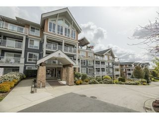 """Photo 1: 102 6460 194 Street in Surrey: Clayton Condo for sale in """"Water Stone"""" (Cloverdale)  : MLS®# R2572204"""