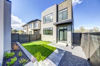 Photo 2: 102 Valour Circle SW in Calgary: Currie Barracks Detached for sale : MLS®# A1073935