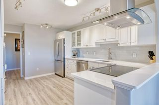 Photo 7: 404 7239 Sierra Morena Boulevard SW in Calgary: Signal Hill Apartment for sale : MLS®# A1153307