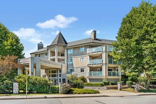 """Photo 1: 303 20145 55A Avenue in Langley: Langley City Condo for sale in """"BLACKBERRY LANE"""" : MLS®# R2609677"""