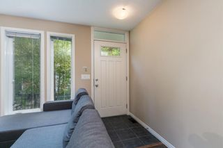 Photo 3: 218 Auburn Bay Square SE in Calgary: Auburn Bay Row/Townhouse for sale : MLS®# A1141951